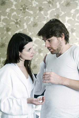 persuading: A woman persuading the man to take medication
