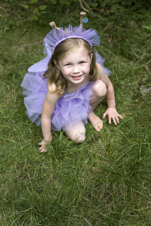 High angle view of little girl wearing ballet dress photo