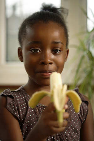 eating banana: Girl eating banana Stock Photo