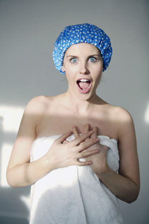 Woman in shower cap and towel screaming photo