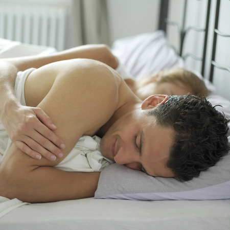 Couple sleeping comfortably photo
