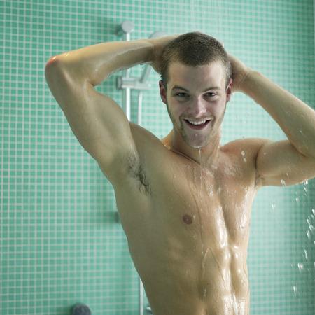 shower man: Man enjoying his shower time Stock Photo