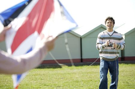 Two men flying a kite photo