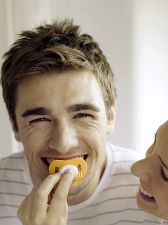 Couple playing with pacifier