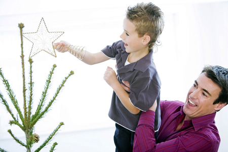 Father and son decorating the Christmas tree photo