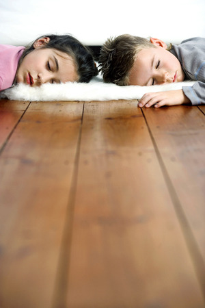 Children sleeping on the floor photo