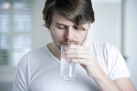 effervescence: A man drinking a glass of effervescence Stock Photo
