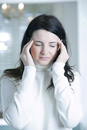 restlessness: A woman having headache