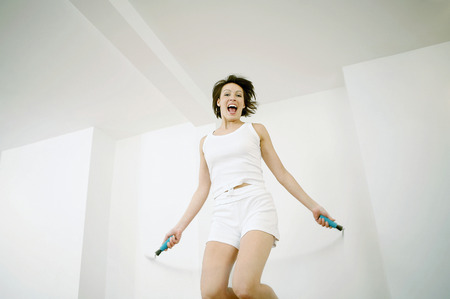 Woman playing with skipping rope photo