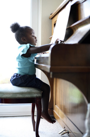 Girl playing piano photo