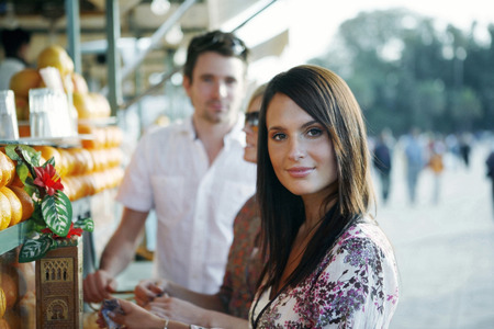 Couple at beverage stall photo