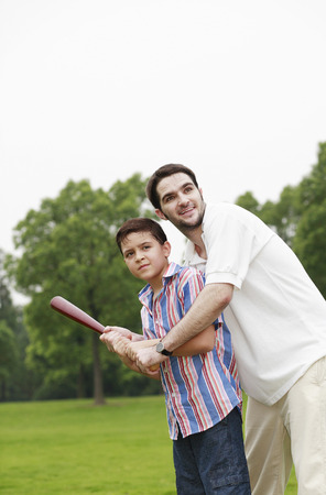 Father and son playing baseball photo