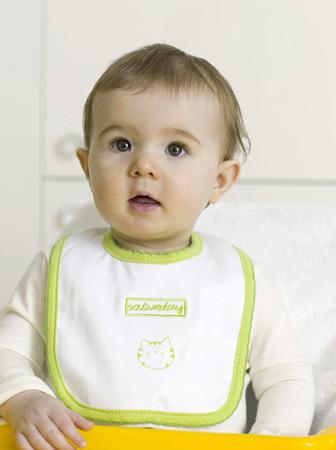 bib: Baby girl wearing bib Stock Photo