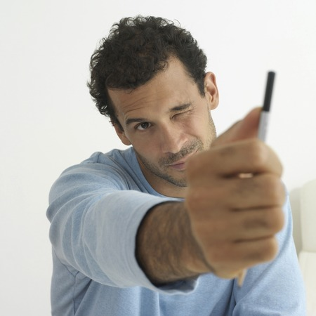 estimation: Man making estimation with his finger