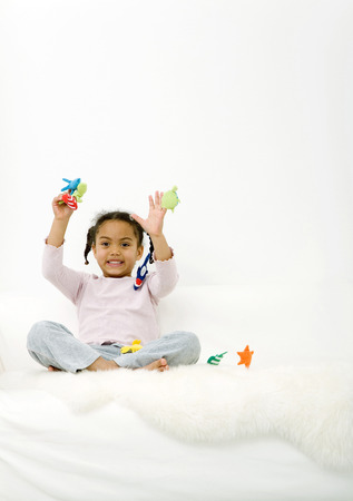 Girl playing with puppet photo