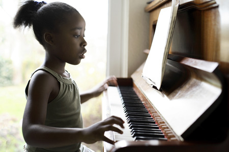 Little girl practicing piano