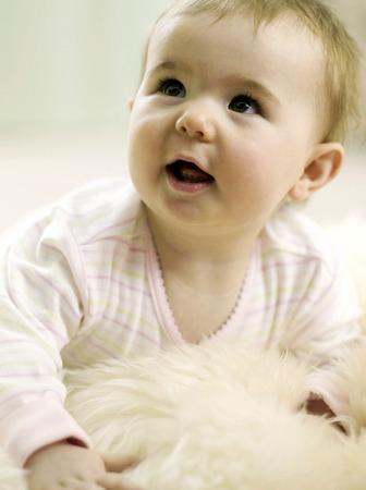 lying forward: Baby girl looking up while lying forward