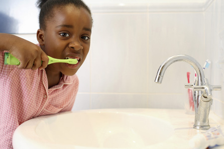 Girl brushing teeth photo