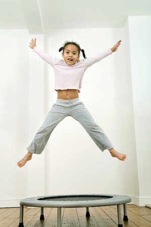 Kid jumping happily photo