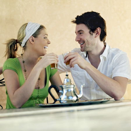 Couple enjoying their drinks photo