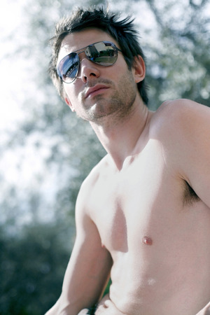barechested: Bare-chested man with sunglasses