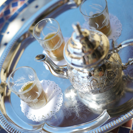 Teapot and glasses on tray photo