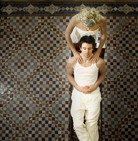 Lady massaging her boyfriend photo