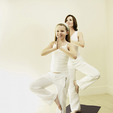 daughter mother: Mother and daughter practicing yoga