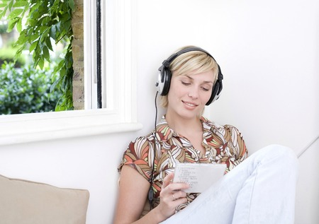 Woman listening to music with headphones photo