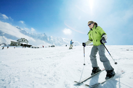 Female skier on skis photo