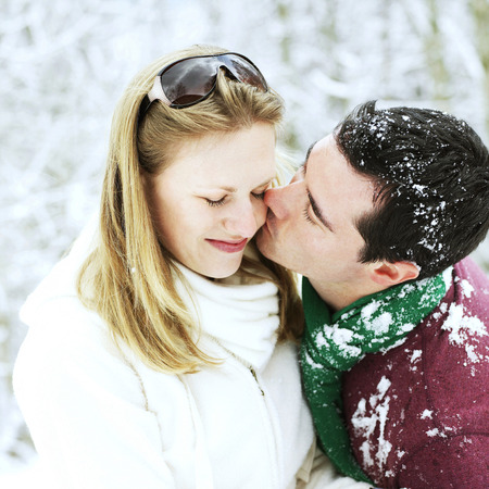 peck: Man giving his girlfriend a peck on the cheek