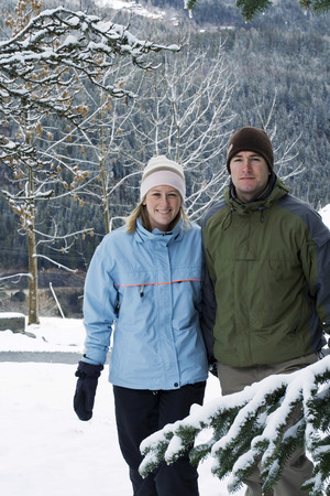 Couple walking outdoor in winter clothing photo