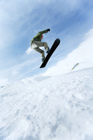 Male snowboarder in air photo