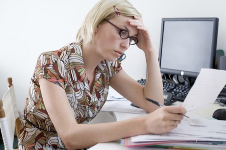 Woman working at desk in a home office photo