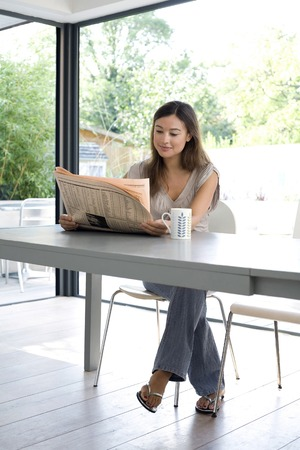 Woman reading newspaper photo
