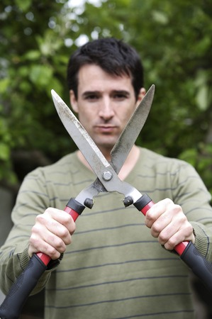 hedge clippers: Man holding hedge clippers Stock Photo