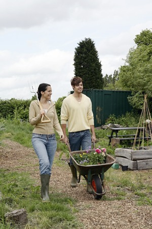 Woman and man working on community garden