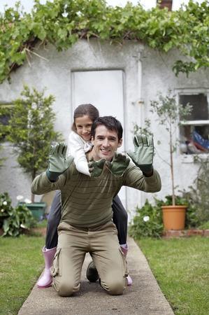 gardening gloves: Man and girl with gardening gloves