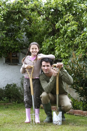 spading fork: Man and girl with gardening tools