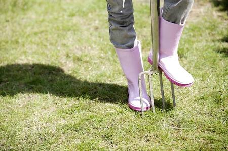 spading fork: Girl stepping on a pitchfork