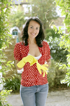 Woman with rubber gloves Stock Photo