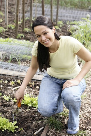 Woman at the community garden photo