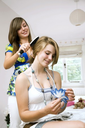 scrunchie: Girl tying hair for another girl