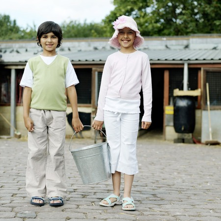he   my sister: Boy and girl holding a bucket together