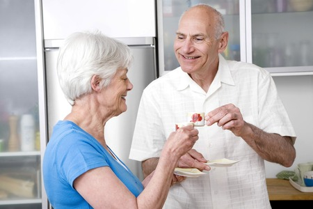 Senior man and woman drinking coffee together