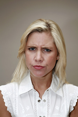 frowns: Woman looking skeptical