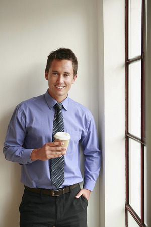 Businessman holding a cup of coffee photo