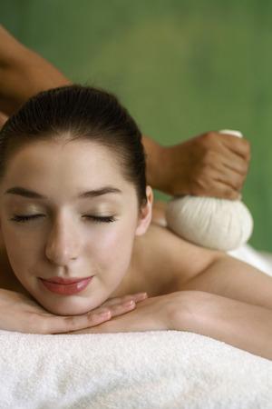Woman enjoying a back massage Stock Photo