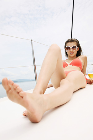Woman sunbathing on yacht photo
