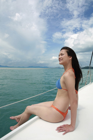 Woman in bikini on yacht photo